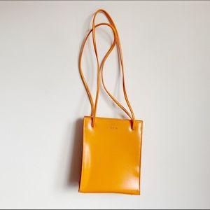 bright orange guess logo shoulder bag